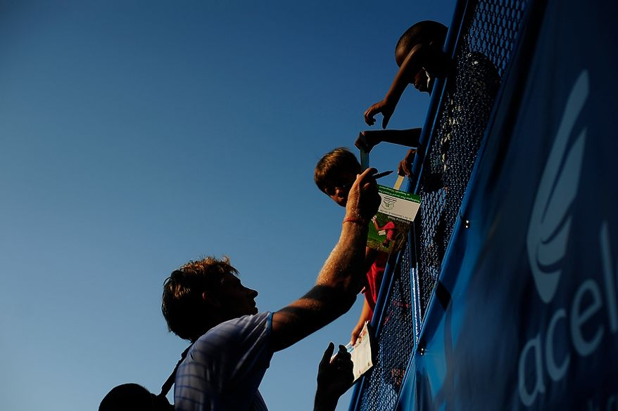 Kevin Anderson signs autographs for fans after defeating Florent Serra at the Citi Open tennis tournament at the William H.G. FitzGerald Tennis Center, Washington D.C., Thursday, August 2, 2012.  (Ryan M.L. Young/The Washington Times)