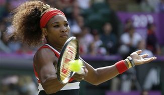 United States' Serena Williams returns a shot to Maria Sharapova of Russia in the women's singles gold medal match at the All England Lawn Tennis Club at Wimbledon, in London, at the 2012 Summer Olympics, Saturday, Aug. 4, 2012. (AP Photo/Elise Amendola)
