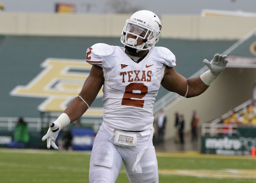 Redskins linebacker Kennan Robinson, as shown with Texas reacts after a tackle against Baylor during an NCAA college football game Saturday, Dec. 3, 2011, in Waco, Texas. (AP Photo/Tony Gutierrez)