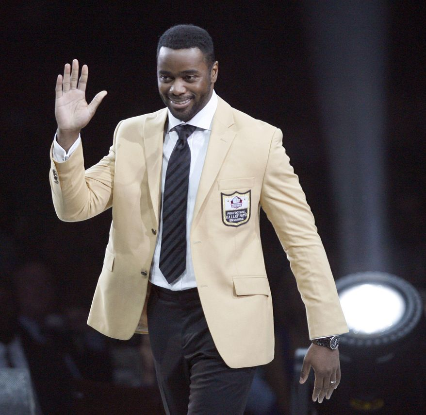 Curtis Martin waves to the crowd after receiving his gold jacket at the Enshrinees' Gold Jacket Dinner at the Memorial Civic Center on Friday, Aug. 3, 2012, in Canton, Ohio. Martin will be enshrined in the Pro Football Hall of Fame on Saturday. (AP Photo/The Repository, Scott Heckel)