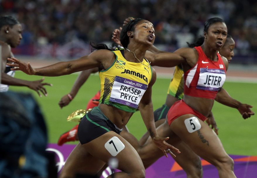 Gold medal winner, Jamaica's Shelly-Ann Fraser-Pryce, left, crosses the finish line ahead of silver medal winner United States' Carmelita Jeter during the women's 100-meter final during athletics competition in the Olympic Stadium at the 2012 Summer Olympics, Saturday, Aug. 4, 2012, in London. (AP Photo/Rebecca Blackwell)