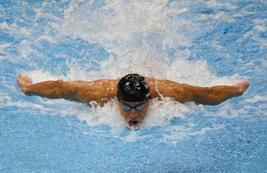 United States' Michael Phelps swims in the men's 100-meter butterfly swimming final at the Aquatics Centre in the Olympic Park during the 2012 Summer Olympics in London, Friday, Aug. 3, 2012. (AP Photo/Julio Cortez)