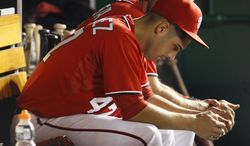 Washington Nationals starting pitcher Gio Gonzalez sits in the dugout in the ninth inning during the second baseball game of a doubleheader against the Miami Marlins, Friday, Aug. 3, 2012, in Washington. The Marlins won 5-2. (AP Photo/Carolyn Kaster)