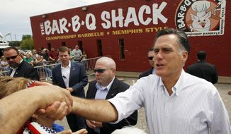 Republican presidential candidate and former Massachusetts Gov. Mitt Romney campaigns at Stepto's BBQ Shack in Evansville, Ind., Saturday, Aug. 4, 2012. (AP Photo/Charles Dharapak)