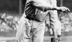 "Walter Johnson, nicknamed ""The Big Train,"" was a pitcher playing from 1907 to 1927  with the Washington Senators.  Johnson was known as a power pitcher of his era, believed to throw the ball over 100 miles per hour.   Later in Johnson's career as baseball manager he had the nickname, ""Old Barney.""    Location and date of this photo is unknown.  (AP Photo)"