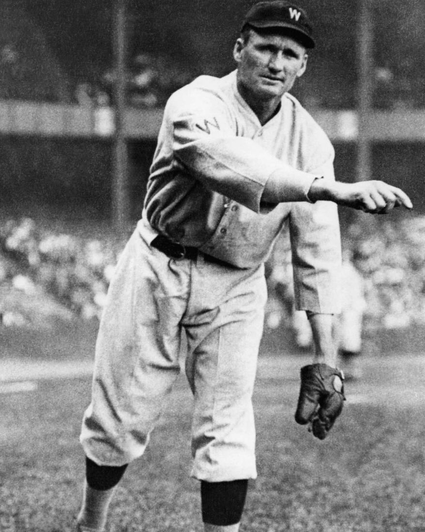 """Walter Johnson, nicknamed """"The Big Train,"""" was a pitcher playing from 1907 to 1927  with the Washington Senators.  Johnson was known as a power pitcher of his era, believed to throw the ball over 100 miles per hour.   Later in Johnson's career as baseball manager he had the nickname, """"Old Barney.""""    Location and date of this photo is unknown.  (AP Photo)"""