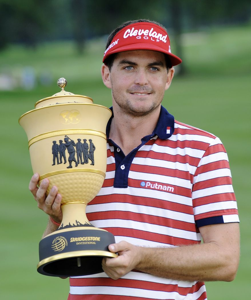 Keegan Bradley holds the trophy after winning the Bridgestone Invitational golf tournament at Firestone Country Club in Akron, Ohio, Sunday, Aug. 5, 2012. (AP Photo/Phil Long)