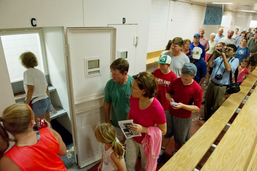 Visitors walk through the visitation room, including taking a look at one of the private visitation rooms, at the Maryland House of Corrections in Jessup, Md. (Barbara L. Salisbury/The Washington Times)