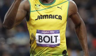 Jamaica's Usain Bolt celebrates after crossing the finish line to win gold in the men's 100-meter final during the athletics competition in the Olympic Stadium at the 2012 Summer Olympics, Sunday, Aug. 5, 2012, in London. (AP Photo/Lee Jin-man)