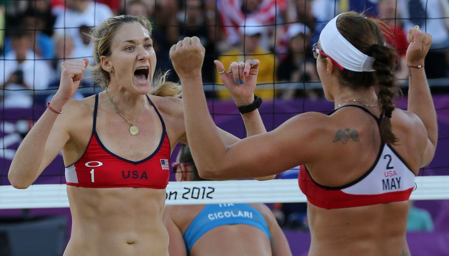 US Kerri Walsh, left, and Misty May-Treanor, right, react during their quarterfinal women's beach volleyball match against Italy at the 2012 Summer Olympics, Sunday, Aug. 5, 2012, in London. (AP Photo/Petr David Josek)