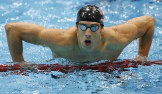 United States' Michael Phelps gets out of the water after swimming butterfly in the men's 4 X 100-meter medley relay at the Aquatics Centre in the Olympic Park during the 2012 Summer Olympics, London, Saturday, Aug. 4, 2012.  (AP Photo/Jae C. Hong)