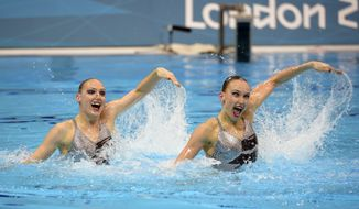 Natalia Ishchenko and Svetlana Romashina compete during the women's duet synchronized swimming technical routine at the Aquatics Centre in the Olympic Park during the 2012 Summer Olympics in London, Sunday, Aug. 5, 2012. (AP Photo/Mark J. Terrill)