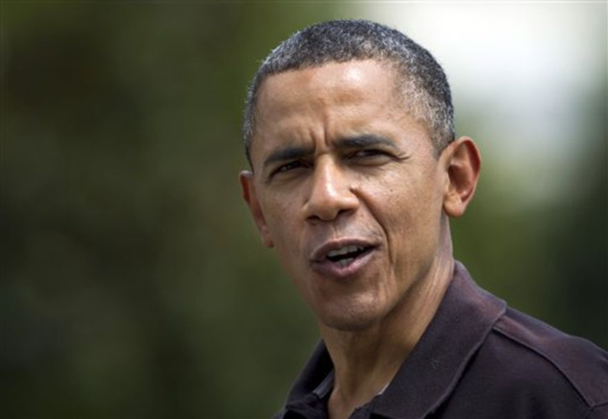 """President Obama tells reporters """"I feel older"""" when asked about his birthday, as he arrives the White House in Washington, Sunday, Aug. 5, 2012. (AP Photo/Manuel Balce Ceneta)"""