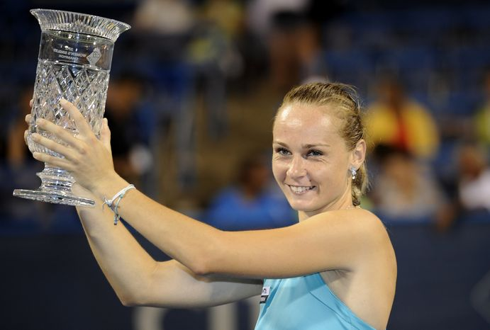 Magdalena Rybarikova, of Slovakia, poses with the trophy after she won the women's final in the Citi Open tennis tournament against Anastasia Pavlyuchenkova, of Russia, against , Saturday, Au