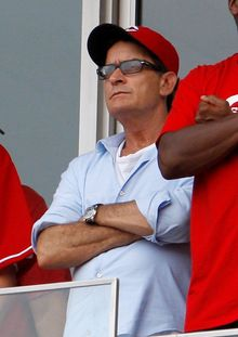 Actor Charlie Sheen watches from the stands during a baseball game between the Pittsburgh Pirates and the Reds in Cincinnati on Saturday. (Associated Press)