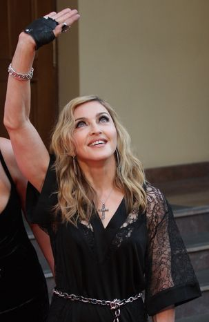 U.S. singer Madonna greets her fans at the opening of the new fitness club in Moscow, Russia, Monday, Aug. 6, 2012 (Associated Press)