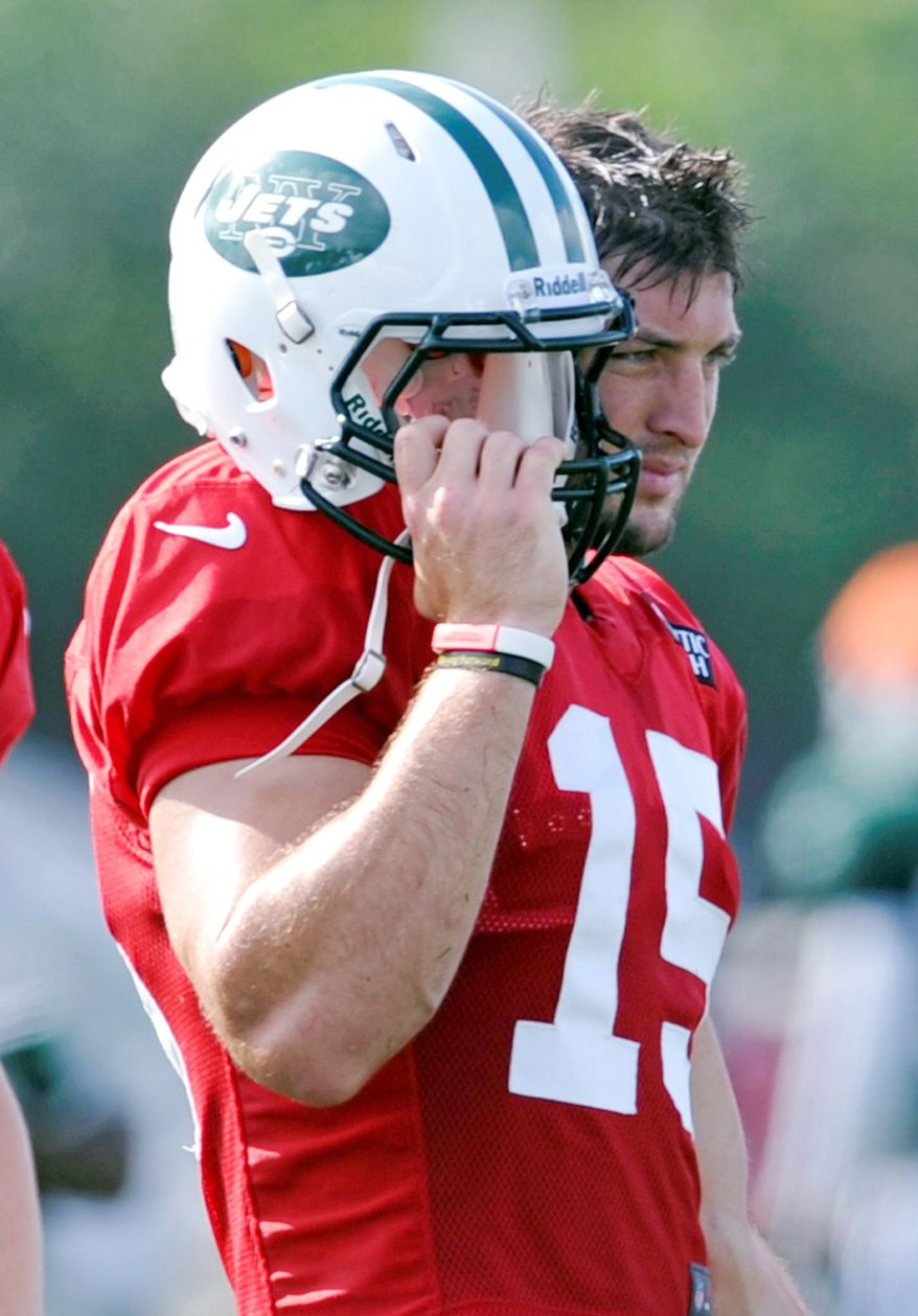New York Jets quarterback Tim Tebow watches practice at NFL football training camp on Sunday, July 29, 2012, in Cortland, N.Y. (AP Photo/Bill Kostroun)