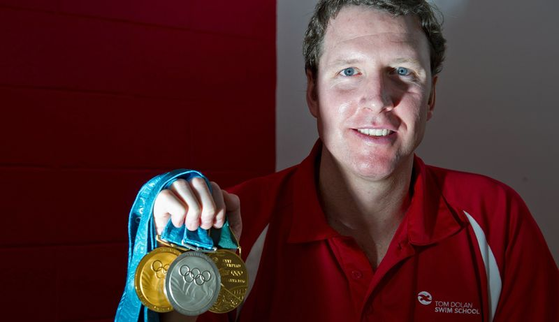 Tom Dolan, who won gold medals in the 400 individual medley in 1996 and 2000, opened the Tom Dolan Swim School in Dulles, Va., in February. He does not teach but designed the program. (Barbara L. Salisbury/The Washington Times)