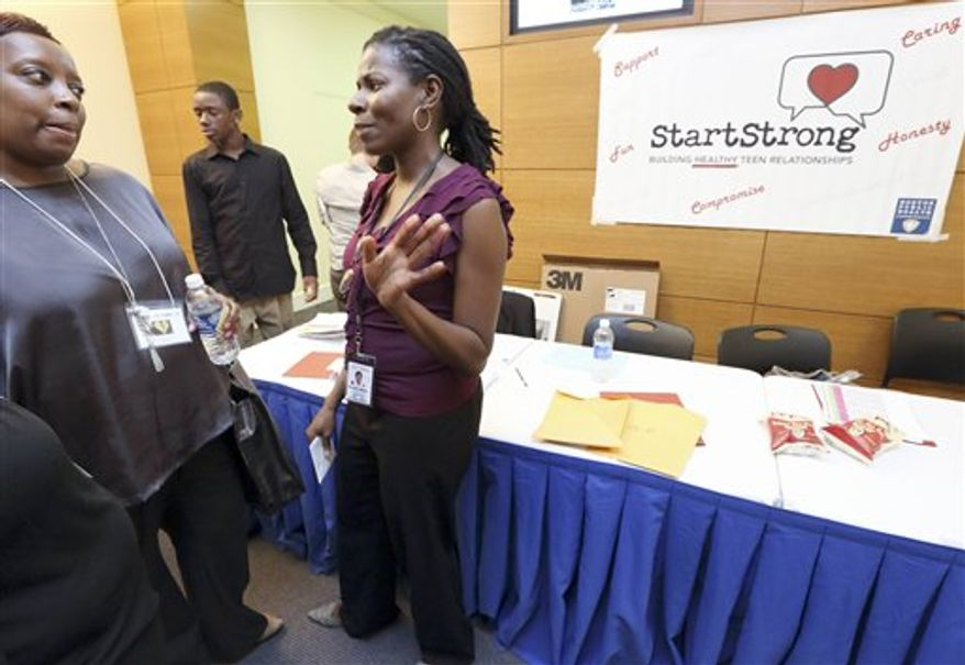 Director of the StartStrong project at the Boston Public Health Commission, Nicole Daley, right, speaks with a participant during the Break-Up Summit at Simmons College in Boston, Thursday, July 26, 2012. The summit, sponsored by the Boston Public Health Commission, is part of a national program aimed at preventing dating violence. (AP Photo/Michael Dwyer)
