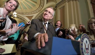 **FILE** Senate Majority Leader Harry Reid, Nevada Democrat, announces July 31, 2012, to reporters on Capitol Hill in Washington that he and GOP House Speaker John Boehner have reached an agreement to keep the government running on autopilot for six months when the current budget year ends on Sept. 30. (Associated Press)