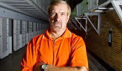 Gary Hornbaker, who served as warden of the Maryland House of Corrections from 2006 until it closed down in 2007, poses for a portrait in one of the cell block corridors on Sunday, Aug. 5, 2012.  (Barbara L. Salisbury/The Washington Times)