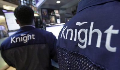**FILE** Knight Capital specialists work Aug. 3, 2012, at their posts on the floor of the New York Stock Exchange. (Associated Press)