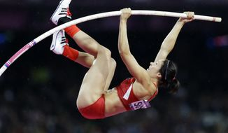 United States' Jennifer Suhr competes to win gold in the women's pole vault final during the athletics in the Olympic Stadium at the 2012 Summer Olympics, London, Monday, Aug. 6, 2012. (AP Photo/Lee Jin-man)