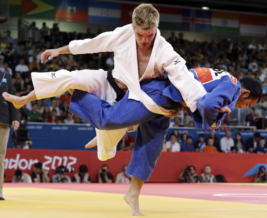 Nicholas Delpopolo of the United States (left) and Nyam Ochir Sainjargal of Mongolia compete July 30, 2012, during the men's 73-kg judo competition at the 2012 Summer Olympics in London. (Associated Press)