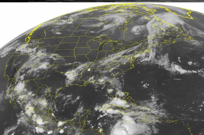 This NOAA satellite image, taken Aug. 6, 2012 at 1:45 a.m. EDT, shows cloud cover ahead of a cold front that extends from the Lower Great Lakes to the Lower Mississippi Valley. (Associated Press/Weather Underground)