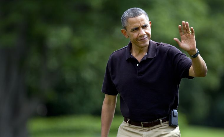 President Obama waves Aug. 5, 2012, as he arrives the White House in Washington from Camp David. (Associated Press)
