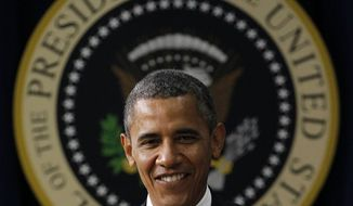 President Obama walks towards the podium to talk about taxes, Friday, Aug. 3, 2012, in the Old Executive Office building of the White House complex in Washington. (AP Photo/Pablo Martinez Monsivais)