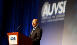 ** FILE ** Michael Huerta, administrator of the Federal Aviation Administration, speaks as one of the keynote speakers at the Association for Unmanned Vehicle Systems International, North America 2012 conference inside the exhibition hall of the Mandalay Bay hotel-casino in Las Vegas, Nev., on Tuesday, Aug. 7, 2012. (Martin S. Fuentes/Special to The Washington Times)