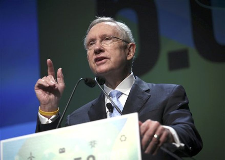 ** FILE ** U.S. Sen. Harry Reid, Nevada Democrat, speaks at the National Clean Energy Summit at the Bellagio in Las Vegas on Tuesday, Aug. 7, 2012. (AP Photo/Las Vegas Review-Journal, Jessica Ebelhar)