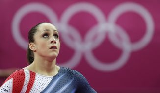 U.S. gymnast Jordyn Wieber looks at the scoreboard after performing during the artistic gymnastics women's floor exercise final at the 2012 Summer Olympics, Tuesday Aug. 7, 2012, in London. (AP Photo/Gregory Bull)
