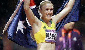 Australia's Sally Pearson celebrates after winning the women's 100-meter hurdles final during the athletics in the Olympic Stadium at the 2012 Summer Olympics, London, Tuesday, Aug. 7, 2012.(AP Photo/Lee Jin-man)