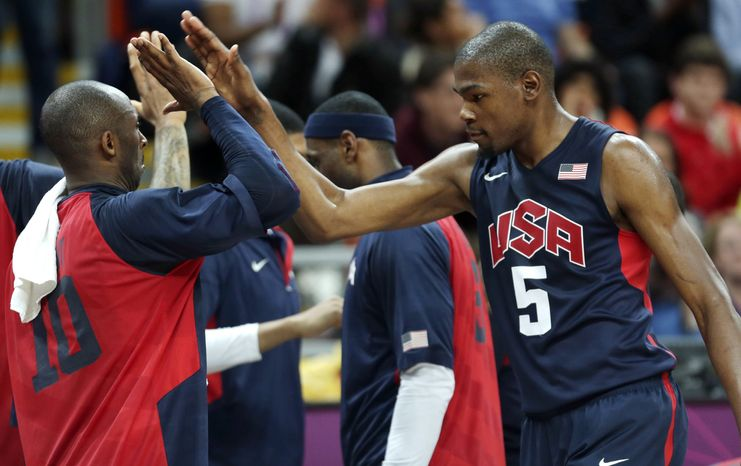USA's Kevin Durant, right, is congratulated by teammate Kobe Bryant during a men's basketball game against Argentina at the 2012 Summer Olympics, Monday, Aug. 6, 2012, in London. (AP Photo/Charles Krupa