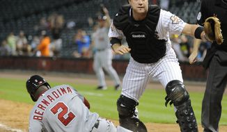Washington Nationals' Roger Bernadina (2) is safe at home as Houston Astros catcher Chris Snyder watches the ball hit the wall on a throwing error by Astros' Brian Bogusevic in the 11th inning of a baseball game Monday, Aug. 6, 2012, in Houston. (AP Photo/Pat Sullivan)