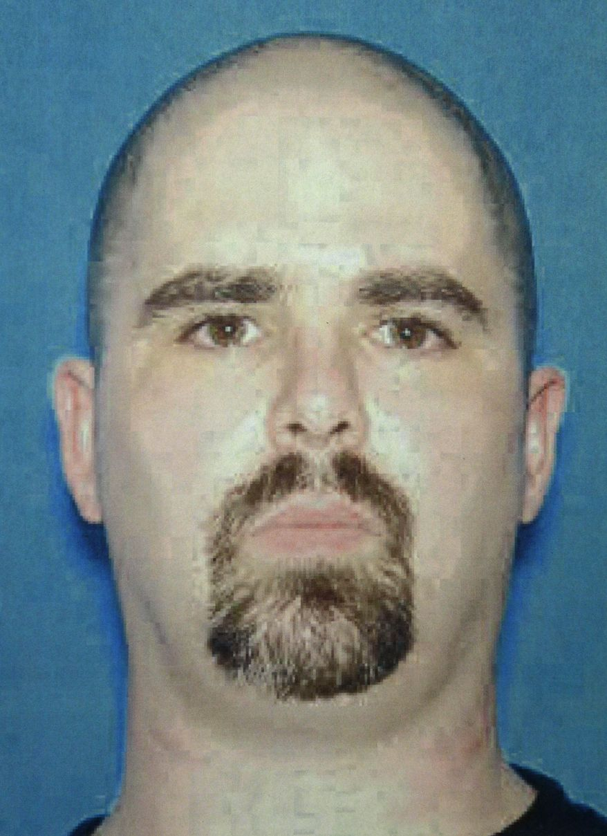 This undated photo provided by the FBI on Monday, Aug. 6, 2012, shows Wade Michael Page, a suspect in the Sunday, Aug. 5, 2012, Sikh temple shootings in Oak Creek, Wis. (AP Photo/FBI)