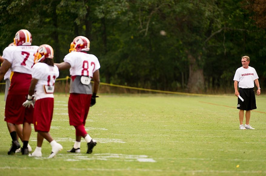 Washington Redskins head coach Mike Shanahan, right, watches afternoon practice at training camp at Redskins Park, Ashburn, Va., Tuesday, August 7, 2012. (Andrew Harnik/The Washington Times)