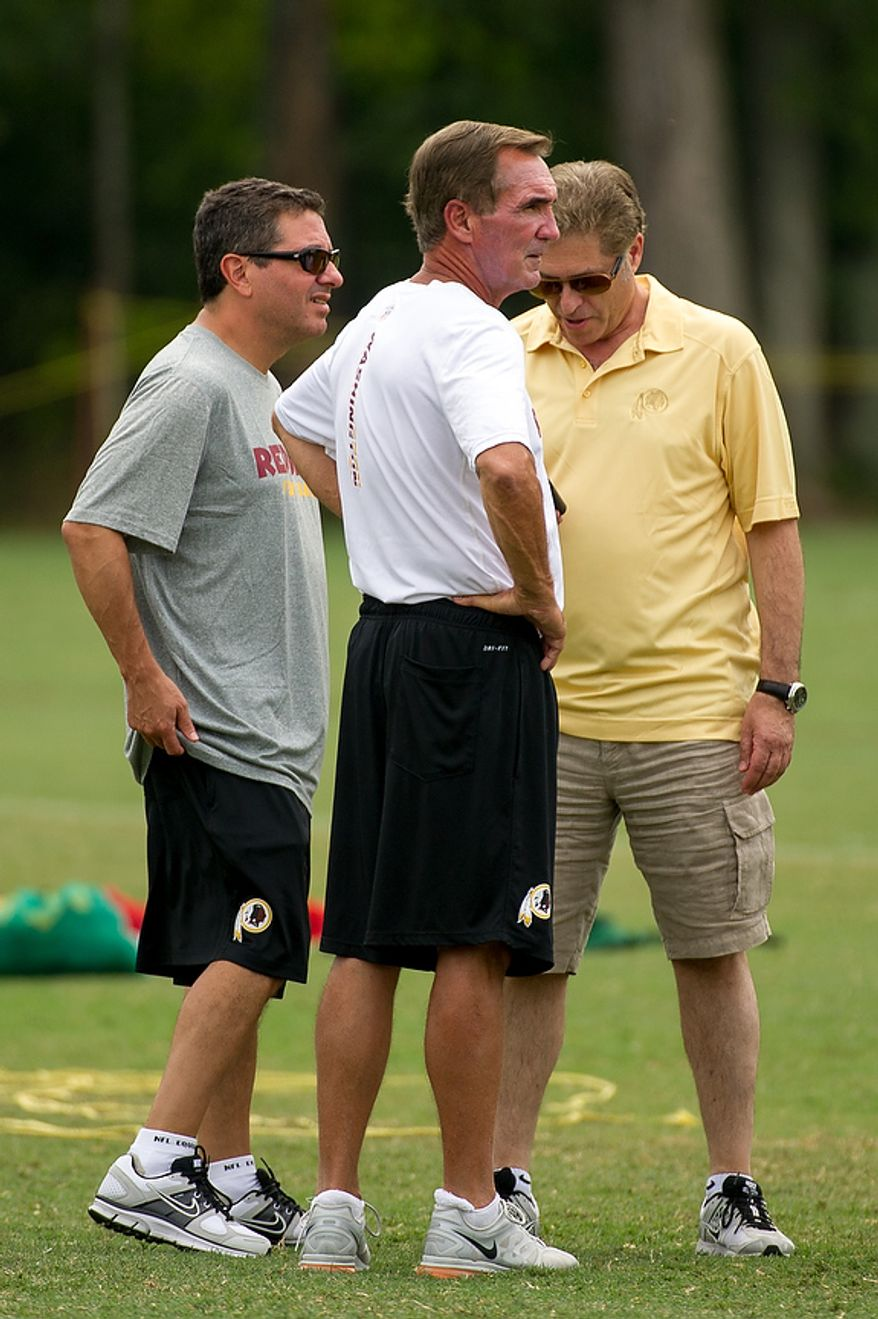 Washington Redskins owner Dan Snyder, left, and Washington Redskins head coach Mike Shanahan, second from left, speak during afternoon practice at training camp at Redskins Park, Ashburn, Va., Tuesday, August 7, 2012. (Andrew Harnik/The Washington Times)