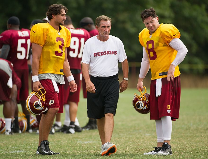 Washington Redskins quarterback Jonathan Crompton (3), left, and Washington Redskins quarterback Rex Grossman (8) talk with Washington Redskins head coach Mike Shanahan, center, following afternoon practice at training camp at Redskins Park, Ashburn, Va., Tuesday, August 7, 2012. (Andrew Harnik/The Washington Times)