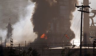 Smoke and flame billow from a crude oil unit Aug. 6, 2012, at the Chevron refinery in Richmond, Calif. The facility makes high-quality products that include gasoline, jet fuel, diesel fuel and lubricants, as well as chemicals used to manufacture many other useful products. (Associated Press/The Contra Costa Times, D. Ross Cameron)