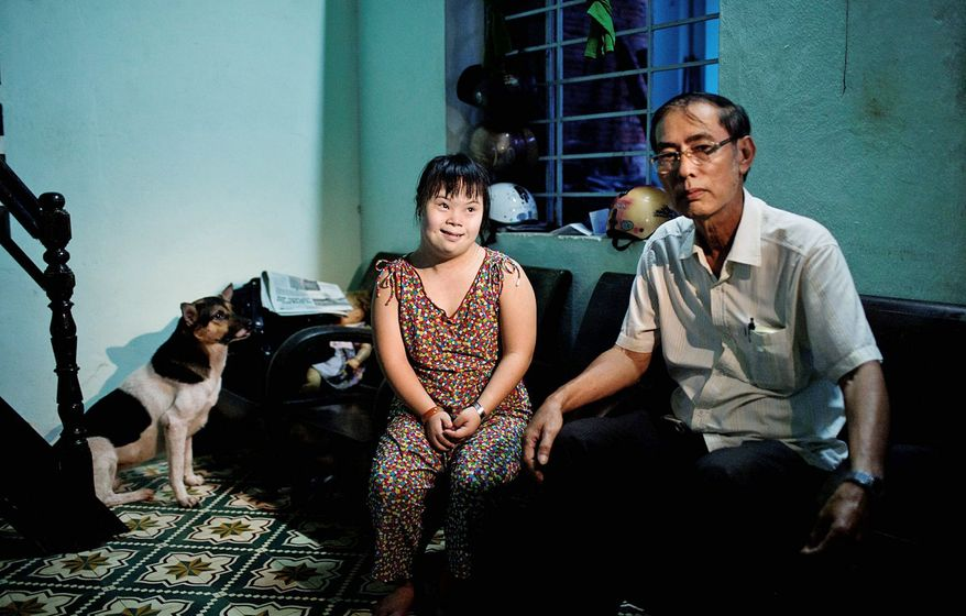 Vo Duoc and his niece Vo Thi Thuy Nga, 24, live in Danang, site of a U.S. base during the Vietnam War. She was born with physical and mental disabilities, and Mr. Duoc and other members of his family are ailing. Blood tests confirm that they have elevated levels of dioxin, the chemical used in Agent Orange. (Associated Press)