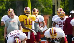 Redskins quarterback Robert Griffin III brings elite speed, a strong arm and a sharp mind to an offensive scheme replete with misdirection in the backfield. But the rookie also has gone through growing pains in training camp. (Andrew Harnik/The Washington Times)