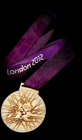 In this image made available by the London Organising Committee of the Olympic Games on Wednesday July 27, 2011 shows the London 2012 Olympic gold medal designed by British artist David Watkins. The back of the medal is displayed in this image all medals will be 85mm in diameter. With one year to go until the opening ceremony of the 2012 Olympic Games, London organizers completed the last of the Olympic Park's permanent venues Wednesday July 27, 2011 and promised to put on a safe and spectacular event that will captivate the world. (AP Photo/LOCOG, Ho)