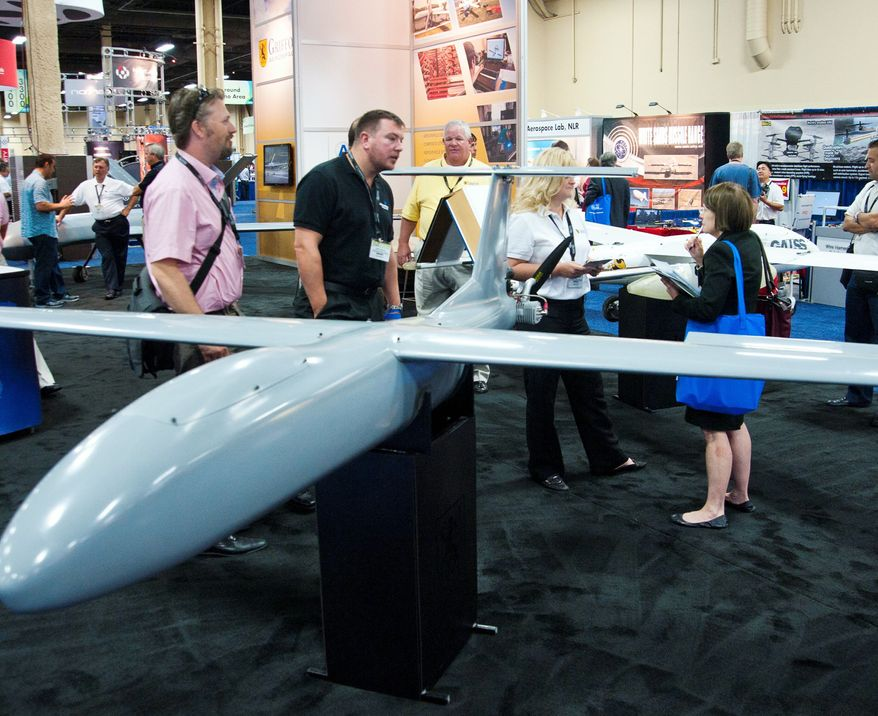 ** FILE ** In this Aug. 8, 2012, file photo, all shapes and sizes of drones fascinate visitors at the Association of Unmanned Vehicles Systems International conference in Las Vegas. (Martin S. Fuentes/Special to The Washington Times)