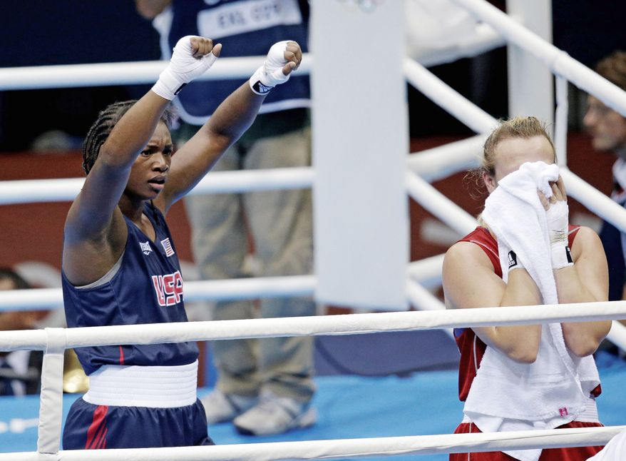 associated press American Claressa Shields raises her arms in triumph after beating a devastated Marina Volnova of Kazakhstan in their middleweight 75-kg boxing semifinal boxing. Shields goes for the gold Thursday.