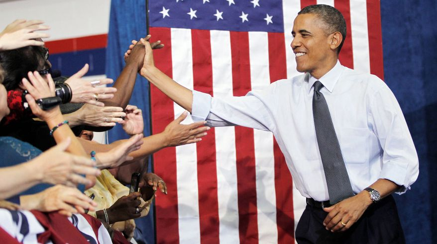 President Obama greets supporters at a campaign event Wednesday in Denver. He is scheduled to make campaign stops Thursday in Colorado Springs and Pueblo during his two-day visit. (Associated Press)