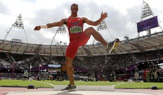 United States' Ashton Eaton reacts Aug. 8, 2012, after his throw in the shot put during the decathlon at the Olympic Stadium in London. (Associated Press)