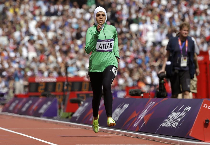 Sarah Attar competes for Saudi Arabia in a women's 800-meter heat at the Olympic Stadium at the 2012 Summer Games in London on Wednesday, Aug. 8, 2012. Attar is the first Saudi woman to compete in track and field at the Olympics. (AP Photo/Anja Niedringhaus)